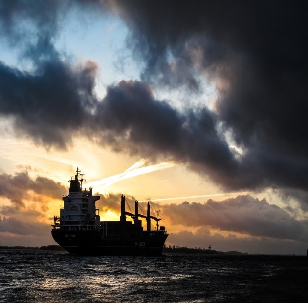 A cargo boat carrying tankers on the ocean