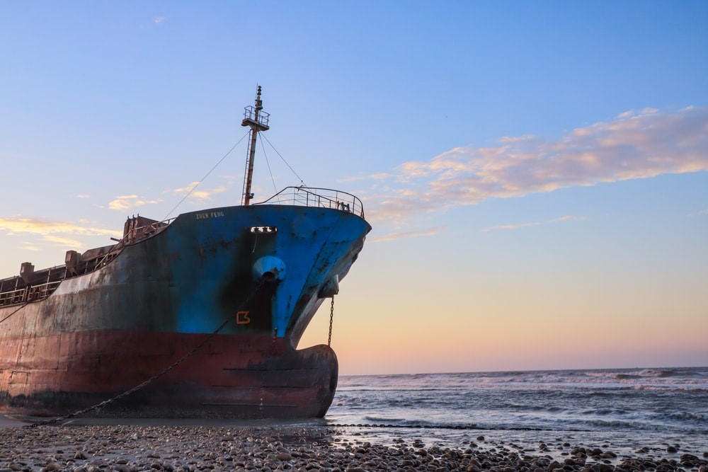 An old ship anchored to the shore
